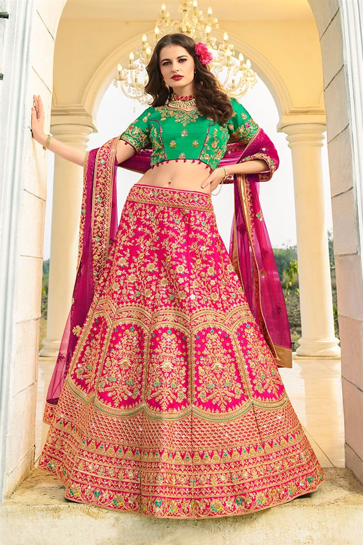 Tantalizing Dark Pink Color Raw Silk Fabric Designer Bridal Wear Lehenga Choli With Net Dupatta