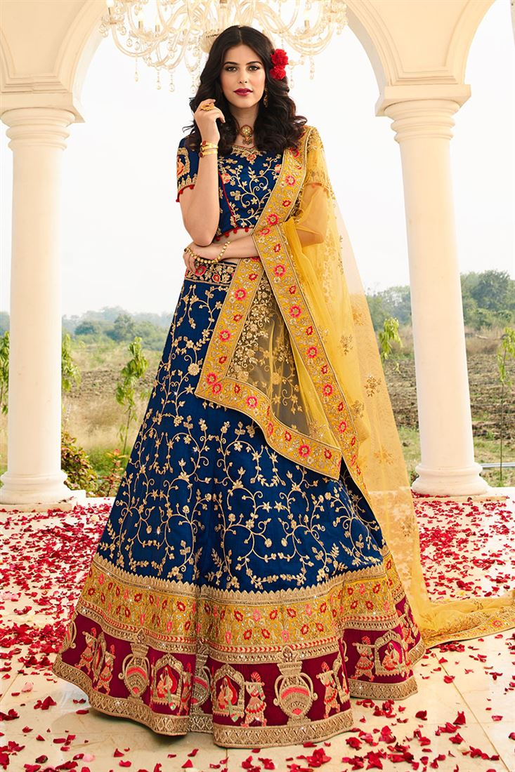 Attractive Blue Color Raw Silk Fabric Bridal Lehenga Choli With Net Dupatta
