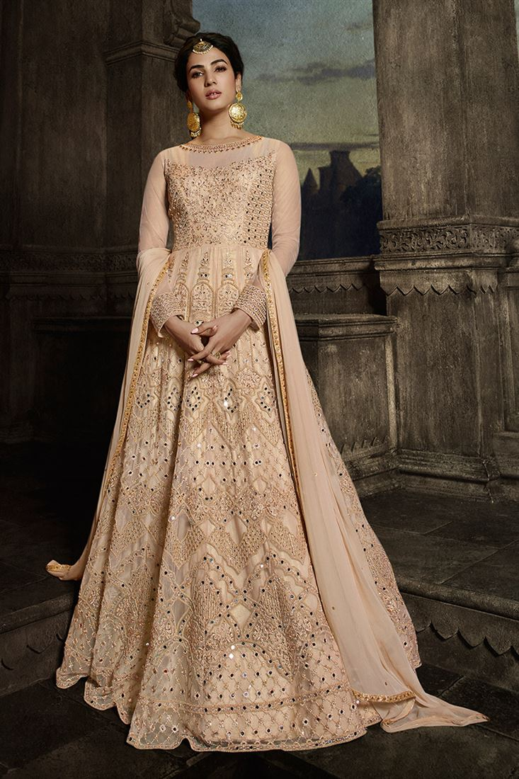 Stunning Sonal Chauhan Peach Color Net Designer Anarkali Suit